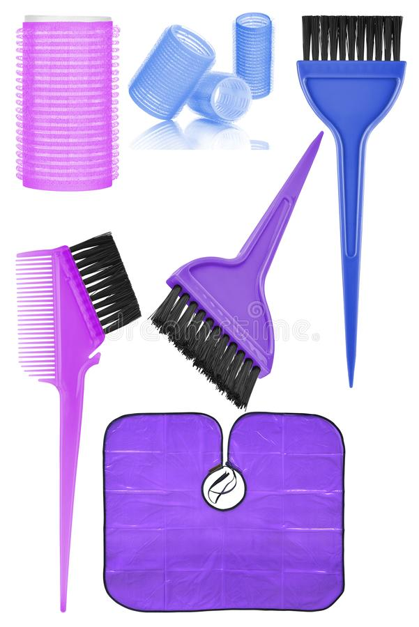 Set of six hair dyeing and styling tools and accessories: hair curlers, dyeing hair brushes and hair dyeing waterproof cape, royalty free stock images