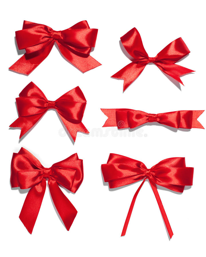 Set of six red ribbon satin bows. Isolated on white stock photography