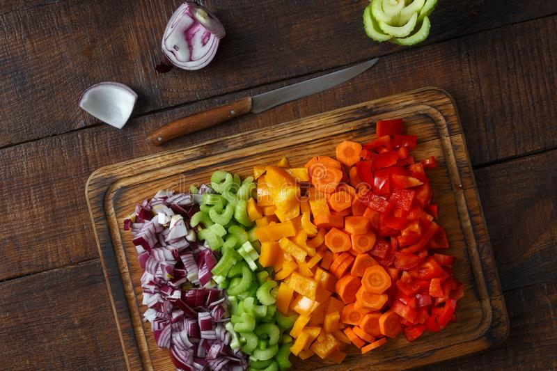 Set sliced fresh vegetables cutting board wooden background Top royalty free stock images