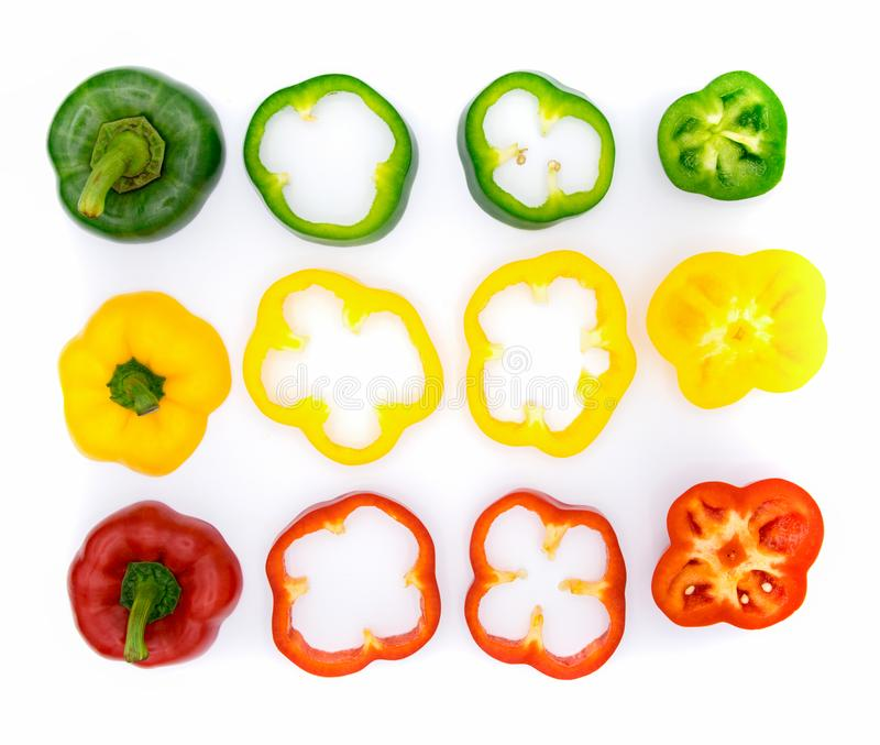 Set of sliced green yellow and red bell pepper stock photography