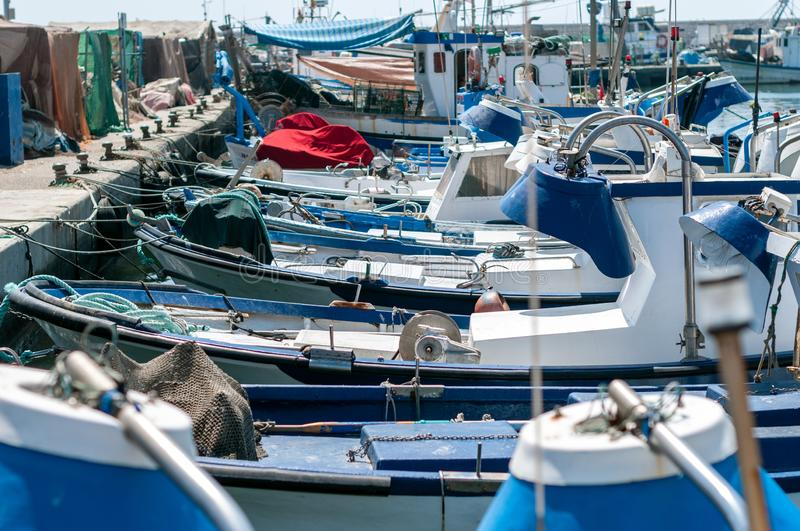 Set of small boats and fishing boats. Beautiful landscape with set of small boats and fishing boats in the sea stock images