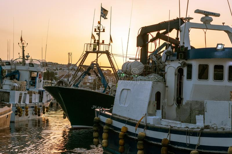 Set of small boats and fishing boats. Beautiful landscape with set of small boats and fishing boats in the sea royalty free stock photography