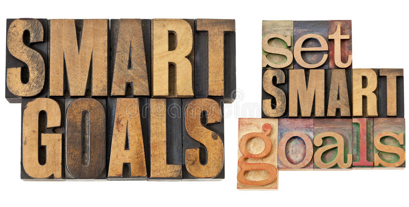 Set SMART goals in wood type. Set SMART goals - isolated text in vintage letterpress wood type royalty free stock photo