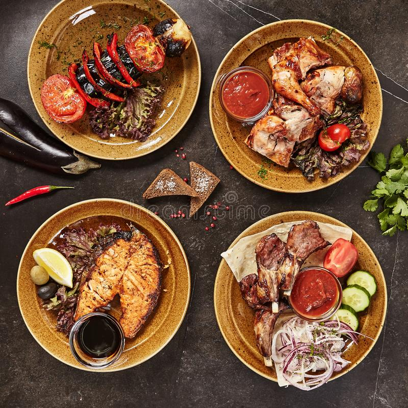 Set of Smoked Grilled BBQ Meat, Fish and Vegetables Top View royalty free stock image