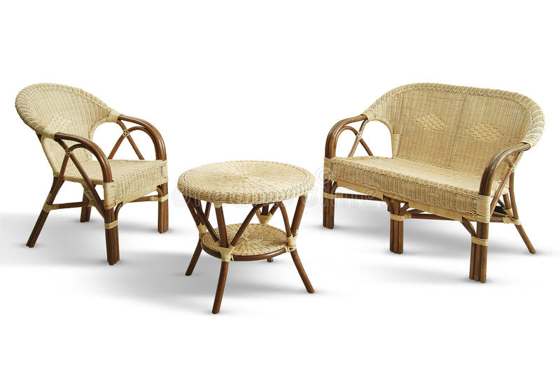 Set with sofa chair and wicker table stock photography