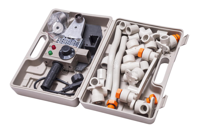 Set for soldering polypropylene. Pipes and fittings stock photo