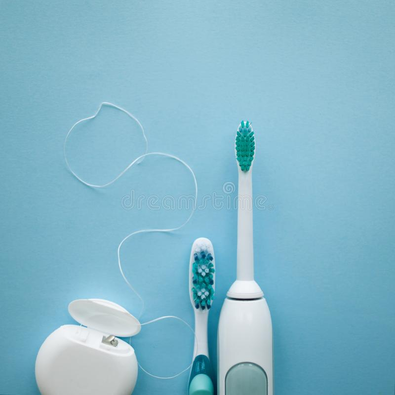 A set of sonic toothbrush, dental floss and classic toothbrush stock photos