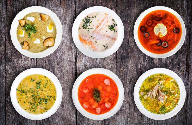 Set of soups. Cream soup with mushrooms, asian fish soup, solyanka, russian borscht, chicken soup, isolated on white. royalty free stock images