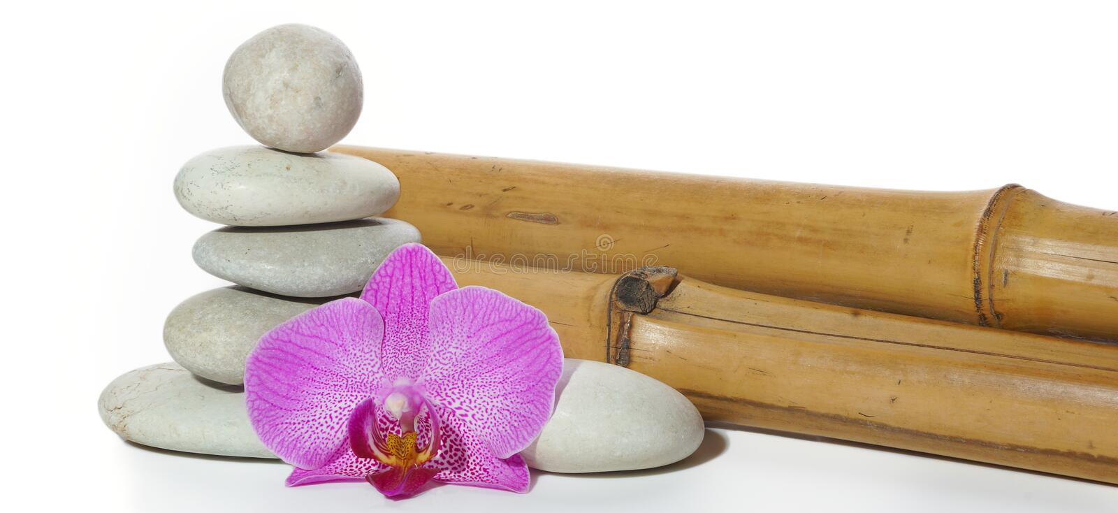 Set for spa with bamboo, stones, folded pyramid and orchid flower.  royalty free stock images