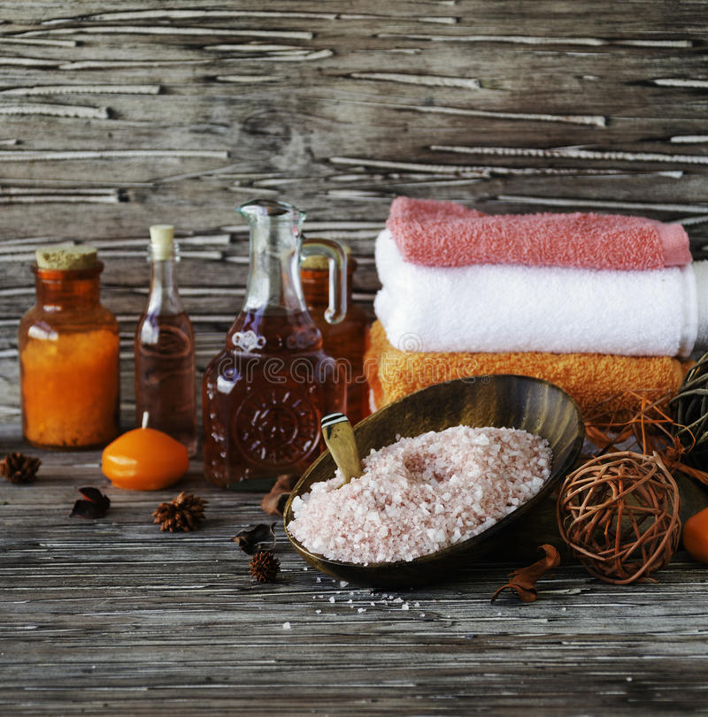 Set for spa with towels, salt and aromatic oils, selective focus stock photos