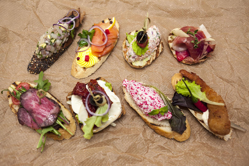 Set of Spanish tapas on the textiles background . Great background for restaurant, cafe stock image