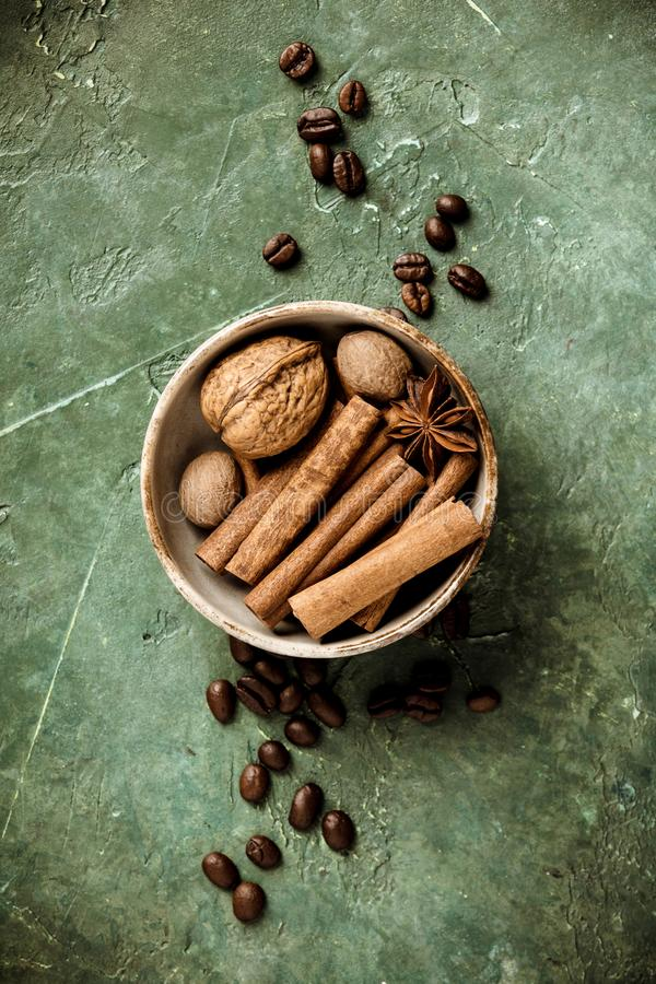 Set of spices and coffee beans on rustic background, flat lay, top view stock image
