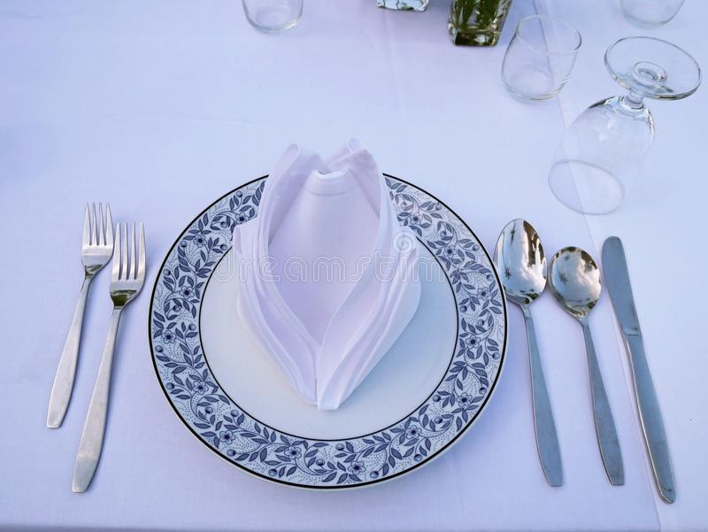 Set of spoons, knif, dish, grass, napkin and forks. royalty free stock photo