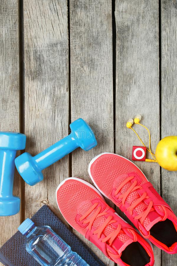 Set of sports accessories for fitness concept with exercise equipment on gray wooden background stock photo