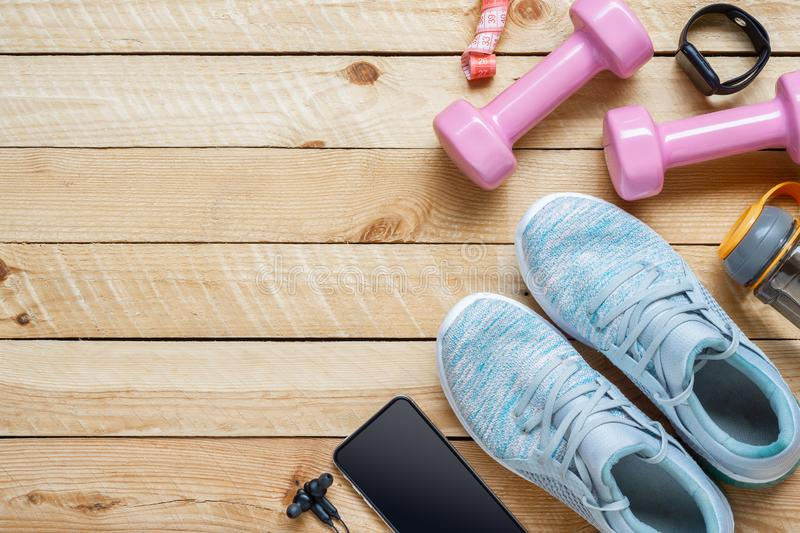 Set of sports accessories for fitness healthy and weight loss dieting concept with exercise equipment on grunge wooden background royalty free stock image