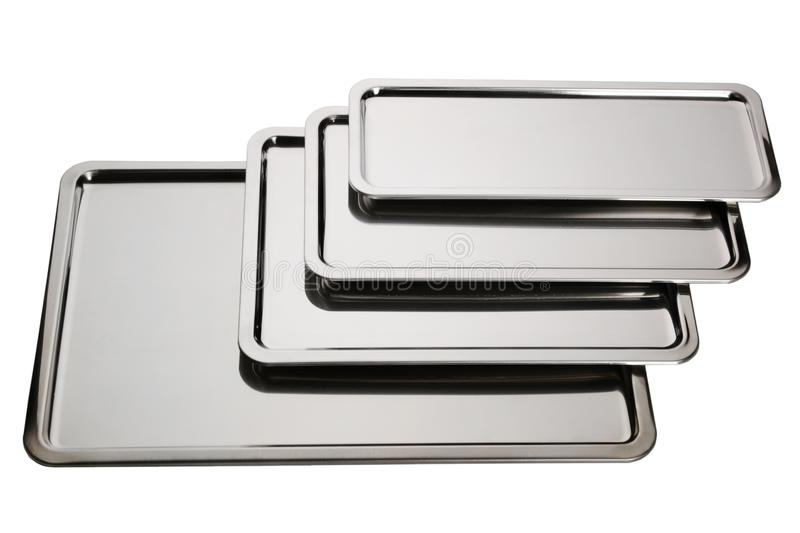 Set of stainless square trays. Empty silver serving trays. Set of stainless square trays on white background. Empty silver serving trays royalty free stock image