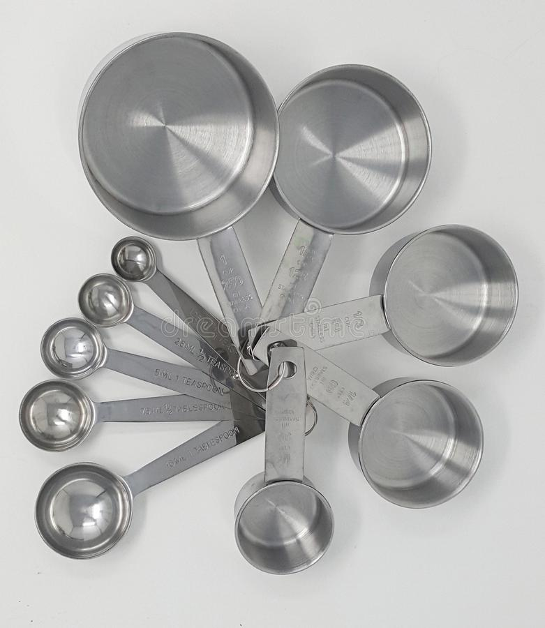Set of Stainless Steel Measuring Cups and Spoons royalty free stock photography