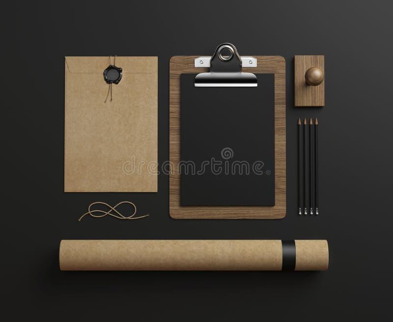 Set of stationery elements on black paper background. Set of stationery elements on paper background stock illustration