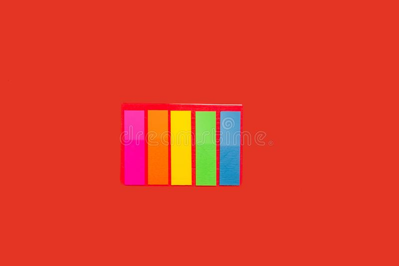 Set of sticky notes. Lying on red background. concept of office stationary stock photo