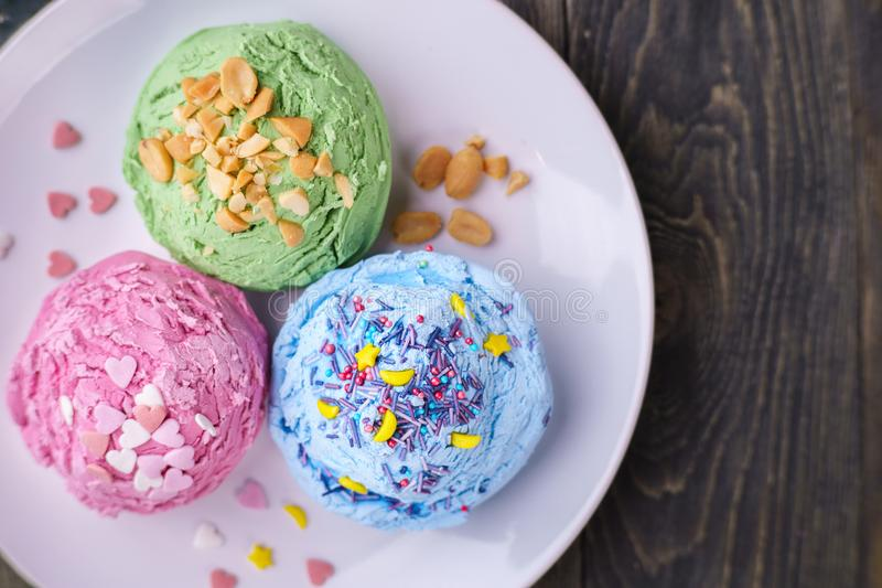 Set of strawberry, pistachio and blueberry flavored ice cream sc royalty free stock photo