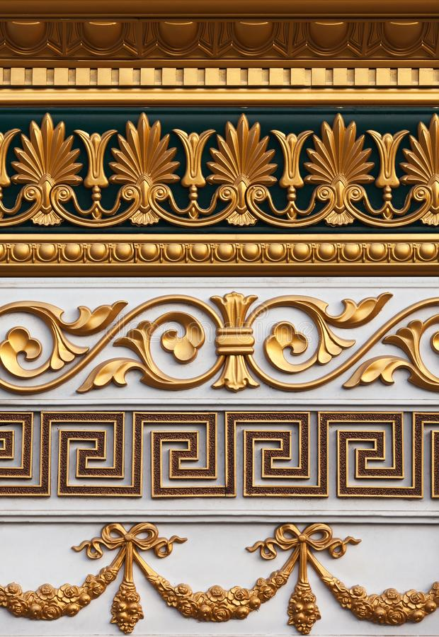 A set of the stucco molding of different styles covered with gold. A set of the stucco molding of different styles covered with gold for decoration of internal stock photo
