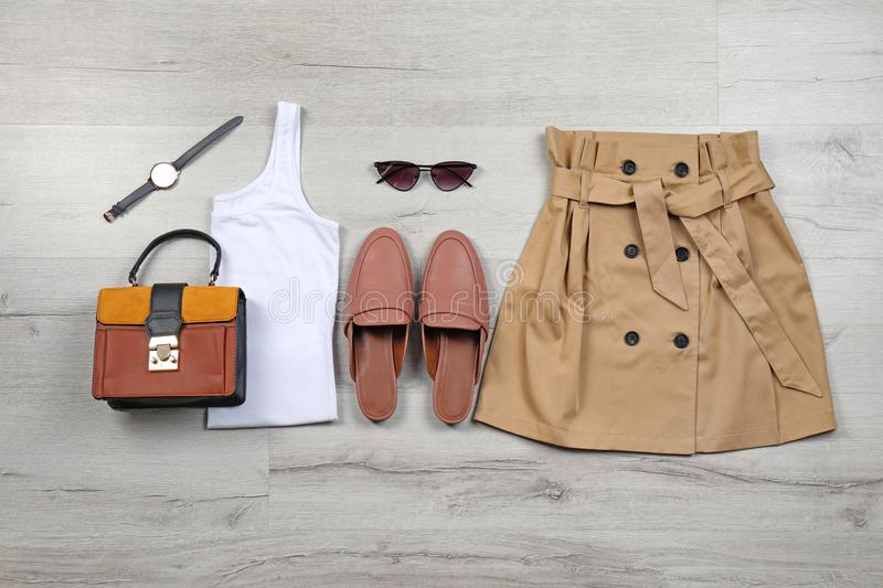 Set of stylish clothes and accessories on floor, flat lay stock photos