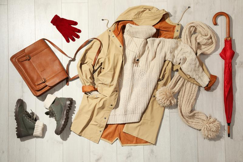 Set of stylish winter outfit. On wooden background, flat lay royalty free stock images