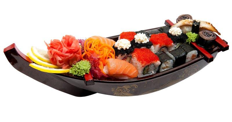 Set Sushi auf hölzernem Standplatz lizenzfreies stockbild