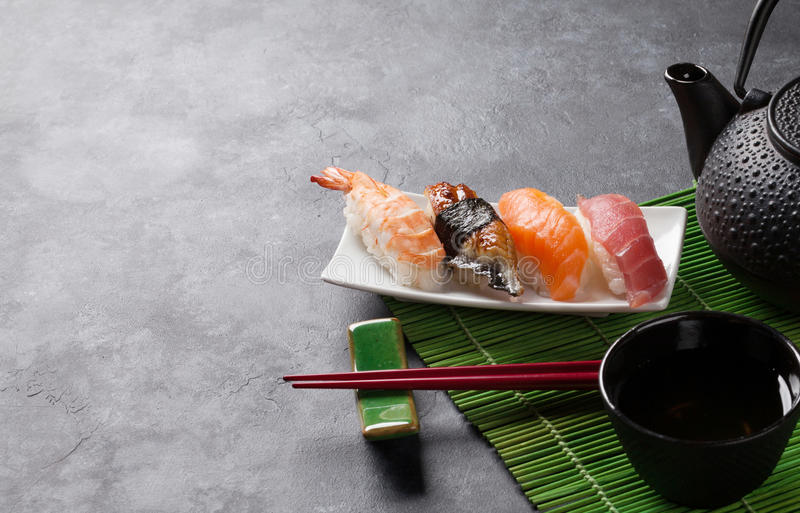 Set of sushi and green tea royalty free stock photo
