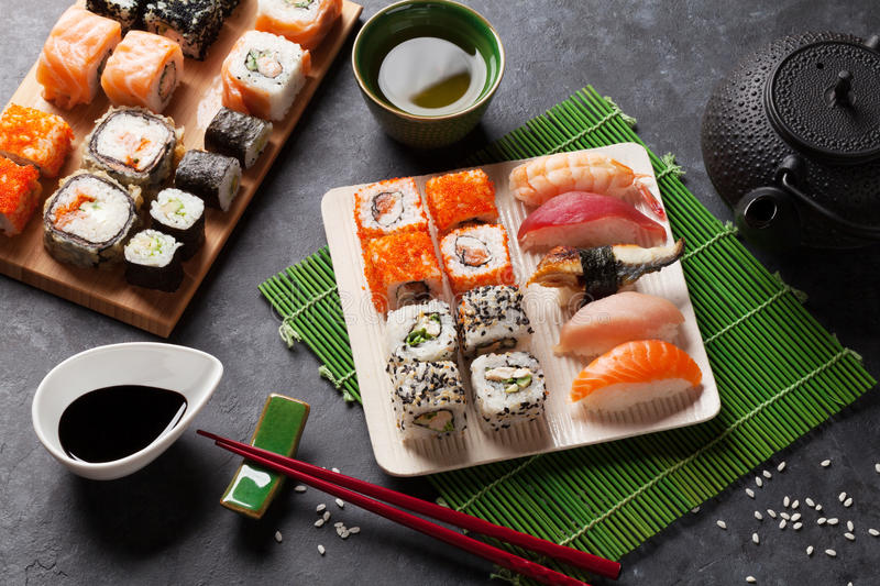 Set of sushi, maki and green tea stock images