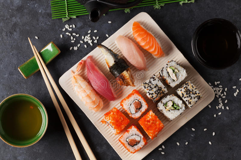 Set of sushi, maki and green tea stock photos