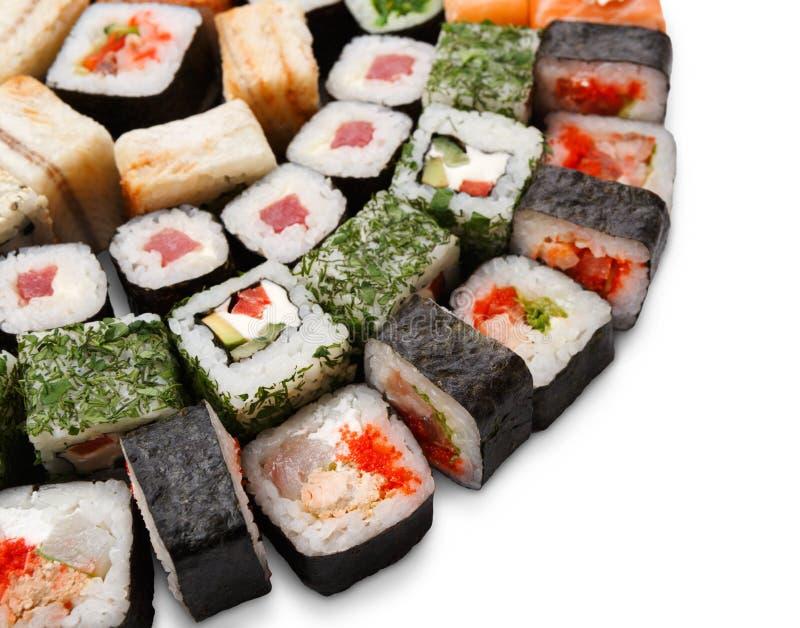 Set of sushi, maki and rolls isolated on white background. Sushi platter closeup isolated on white background. Japanese food restaurant delivery - maki, cheese royalty free stock image