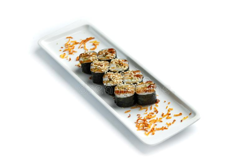 Set sushi on a rectangular plate on an isolated white background royalty free stock images
