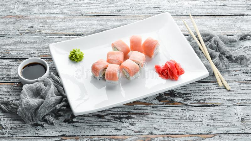 Set Sushi roll with fish and cheese. Chinese traditional dish. Top view. Free copy space royalty free stock photo