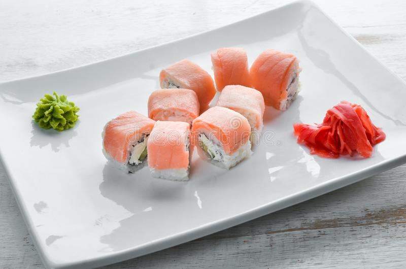 Set Sushi roll with fish and cheese. Chinese traditional dish. Top view. Free copy space royalty free stock image