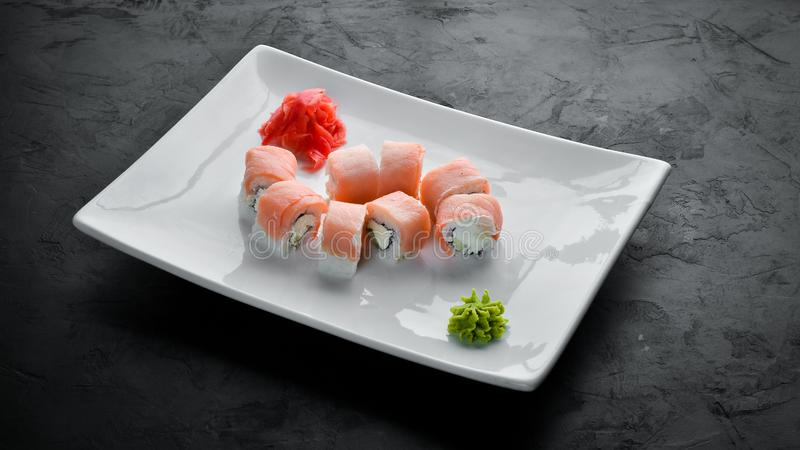 Set Sushi roll with fish and cheese. Chinese traditional dish. Top view. Free copy space stock photography