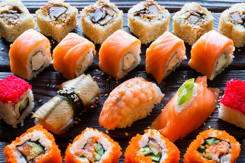 Set of sushi rolls and nigiri on a black background royalty free stock photos