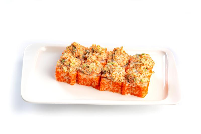 Set sushi rolls on a white plate on an isolated white background. Set sushi rolls on a rectangular white plate on an isolated white background stock photo