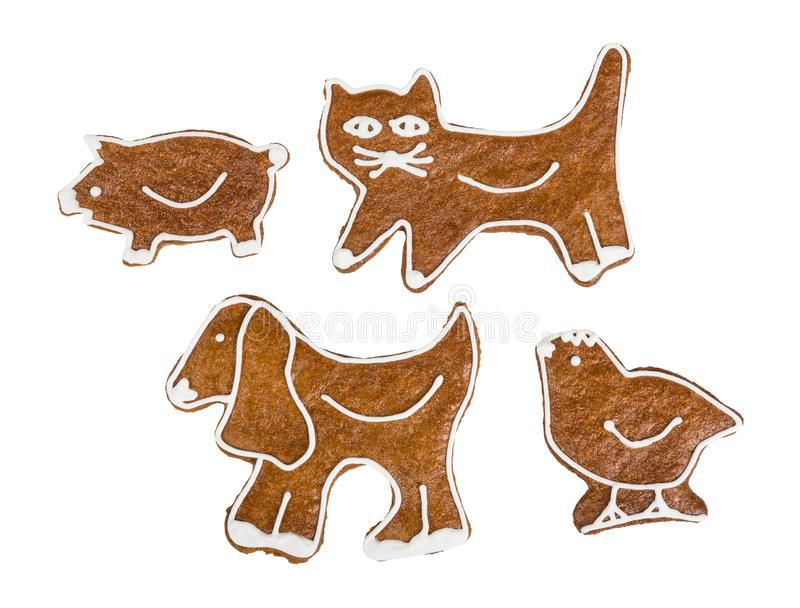 Cute gingerbreads in kitty, doggy, piggy, and chicken shape royalty free stock image
