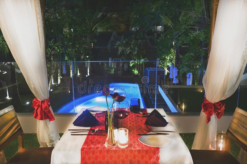 ิset the table for dinner with wine model romantic style near pool
