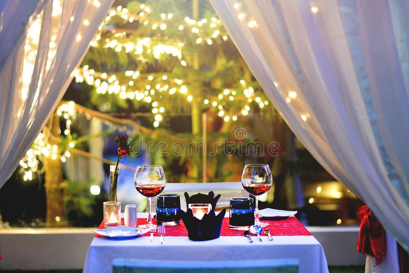 Set the table for dinner time with wine and rose model romantic style for anniversary stock photography