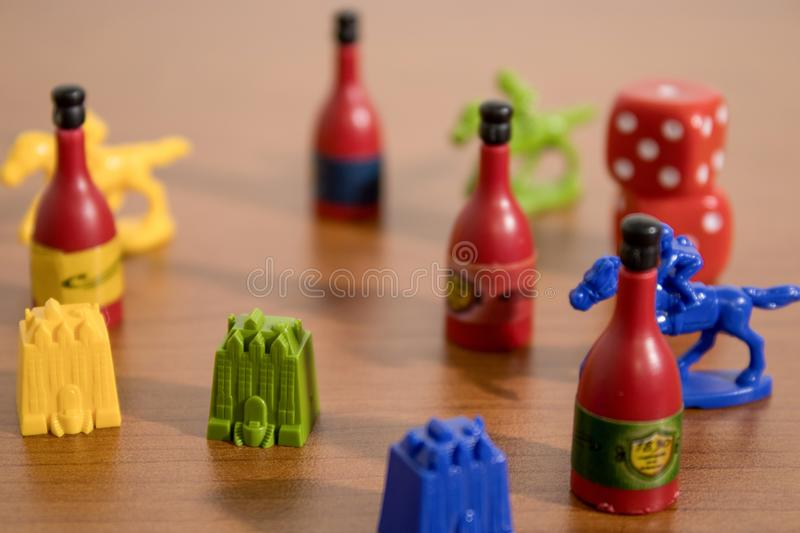 Set table gamings with red dices and many other games. Composition stock images