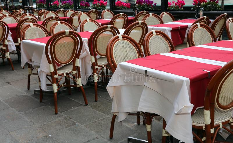 Set tables and chairs of an elegant alfresco restaurant royalty free stock photos