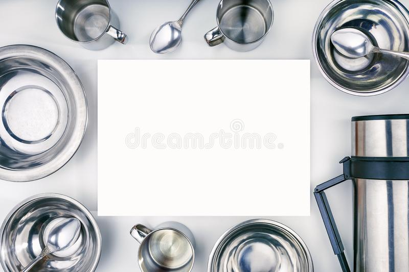 Set of tableware for trekking lies with copy spac. Set of metallic tableware for trekking lies with copy space. top view stock images