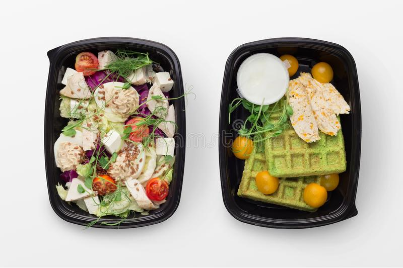 Set of take away difhes in black containers royalty free stock photo
