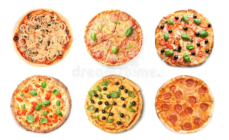 Set of tasty Italian pizzas on white background stock images