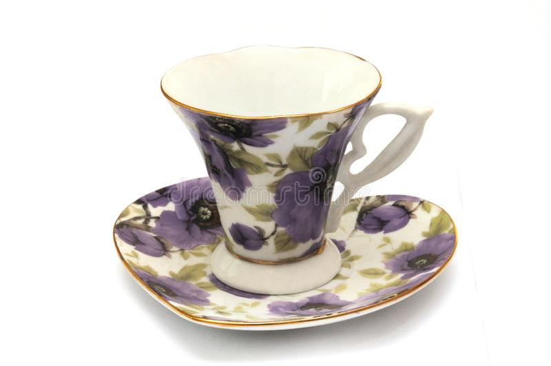 A set of tea cup and saucer with purple flora prints stock photography