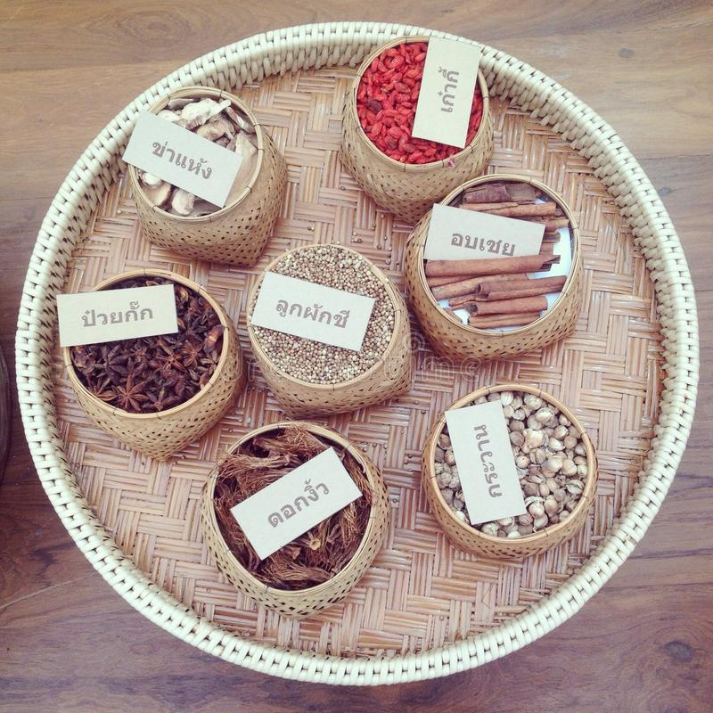 Set of thai spices on round wooden tray: aniseed, cinnamon, pepper. Cooking, travel stock photos
