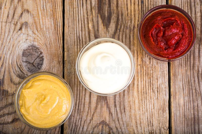 Set of three classic sauces-mayonnaise, ketchup and mustard royalty free stock photography