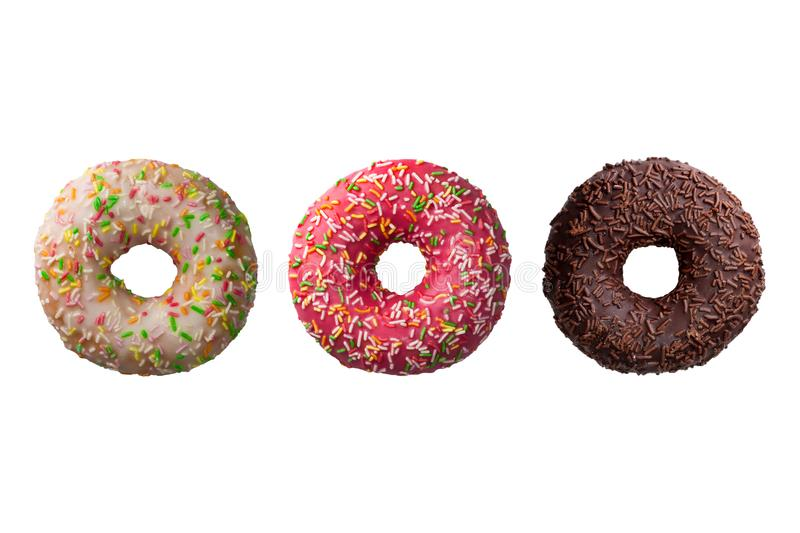 Set of three different colorful donuts isolated on white background stock images